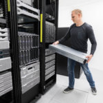 It engineer or consultant rack server. Shot in data center.
