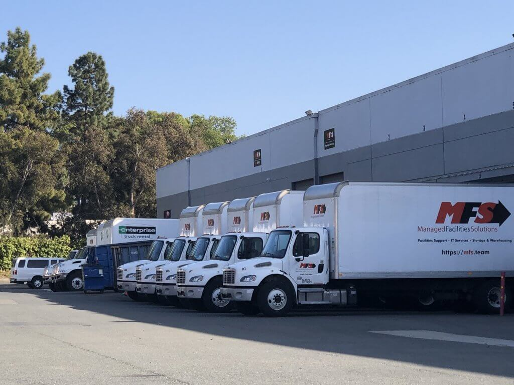 mfs trucks in front of warehouse